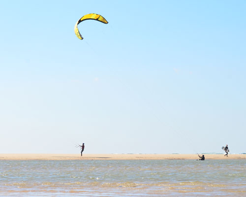 The wild beach of Tarifa and its lagoon are a kitesurfing paradise in Andalucia.